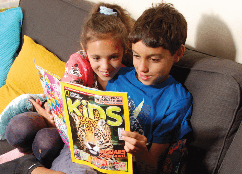 Children reading National Geographic Kids