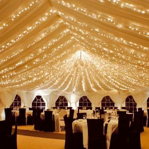 Lots of fairy lights in a marque