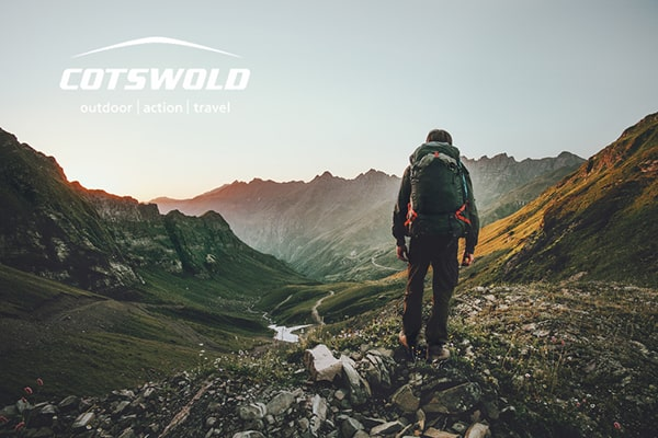 Cotswold Outdoors publicity banner of a man walking in a cold mountainous area