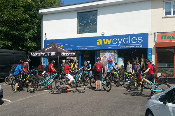 Bicycle fans a group of cyclists outside the AW Cycle shop