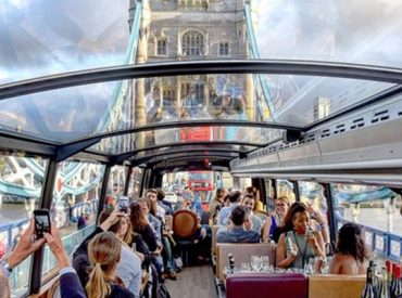 Bus dining aboard looking at panoramic view of London