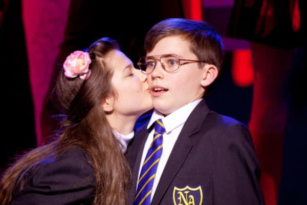 Adrian Mole being kissed by Pandora in the musical