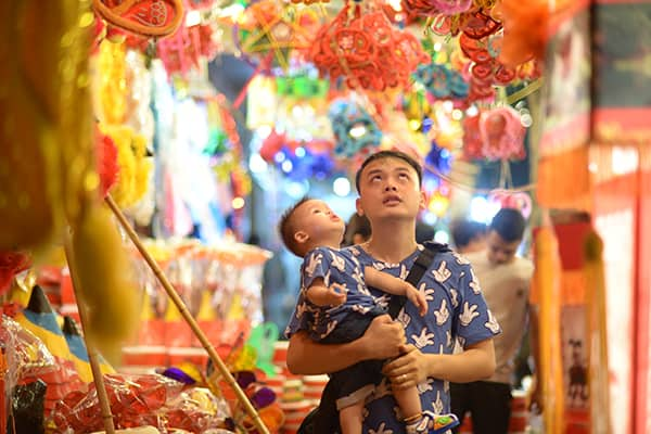 A toddler in father's arms during the Mid-Autumn festival in China