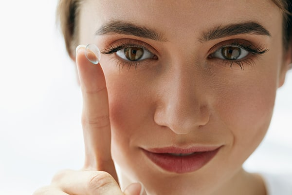 contact lenses on lady's finger