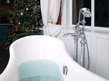 luxury bathroom with a Christmas tree in the corner