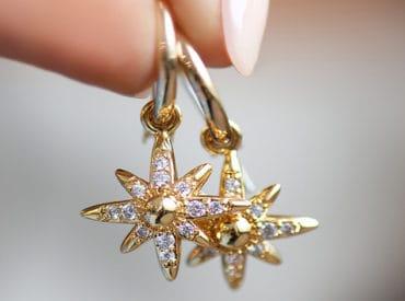 lady holding diamond earrings