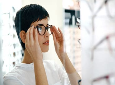 lady trying on glasses