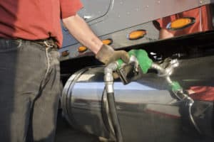 Man filling up an HGV with diesel